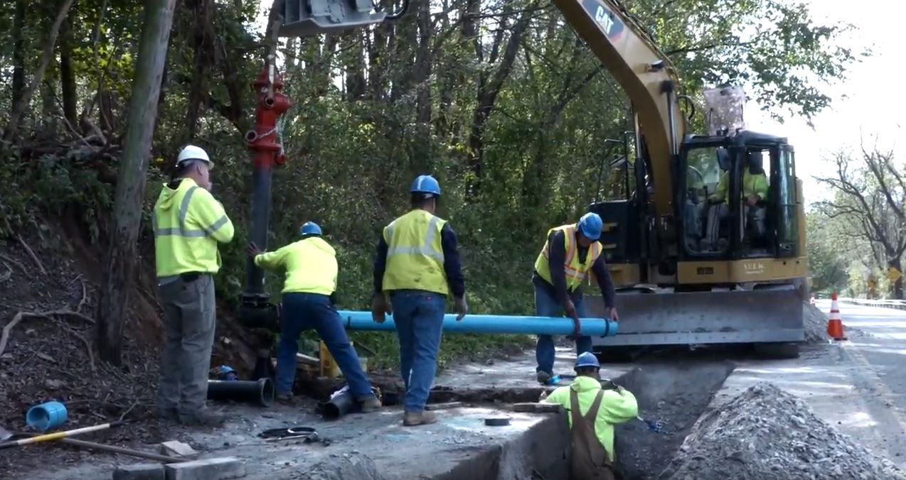 MAWC workers install a new fire hydrant along Clay Pike